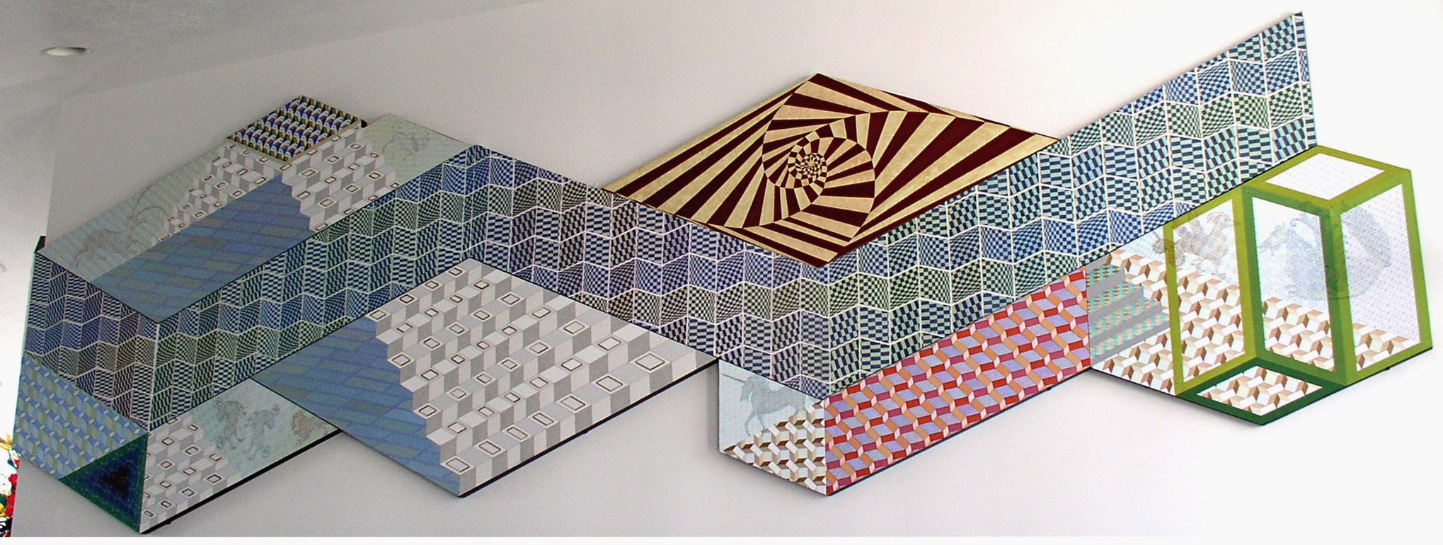 A band of repeating double woven cotton patterns separating a pyramid of painte
